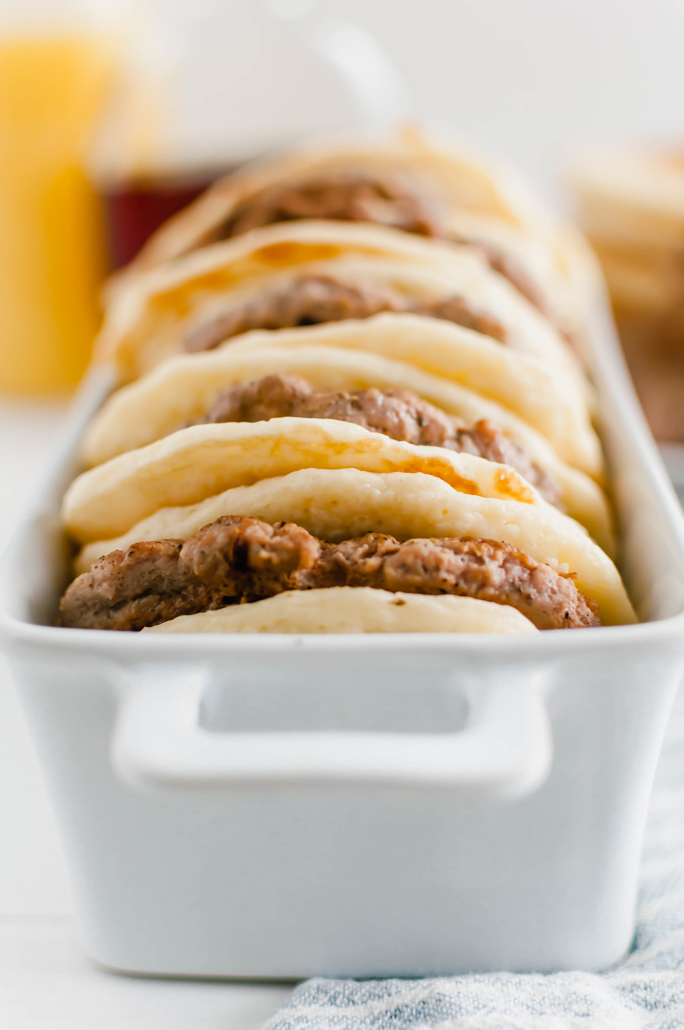 Turkey isn't just for dinner. This Turkey Sausage Breakfast Sandwich is super filling and will keep you energized all day. Juicy homemade turkey sausage patties sandwiched between two fluffy buttermilk pancakes. Maple syrup drizzle optional.