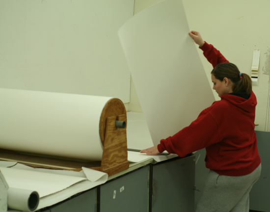 Lori Niemtschk tearing paper