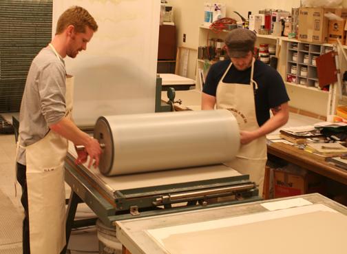 Brandon Gunn and Jason Judd work the roller