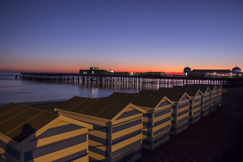 hastings east sussex beach huts pier sunset sun set