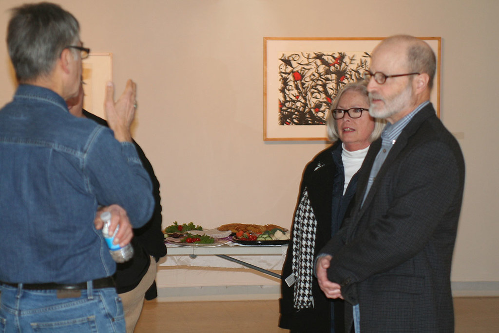 artist with gallery patrons