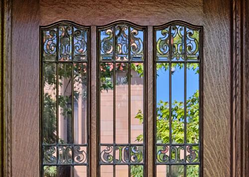 Ornate front door window.
