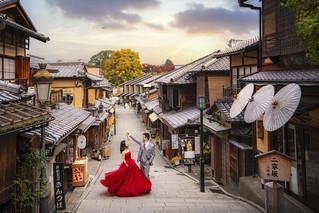 japanese couple take a prewedding photo at the famous Yasaka Jinja shrine in Gion District.