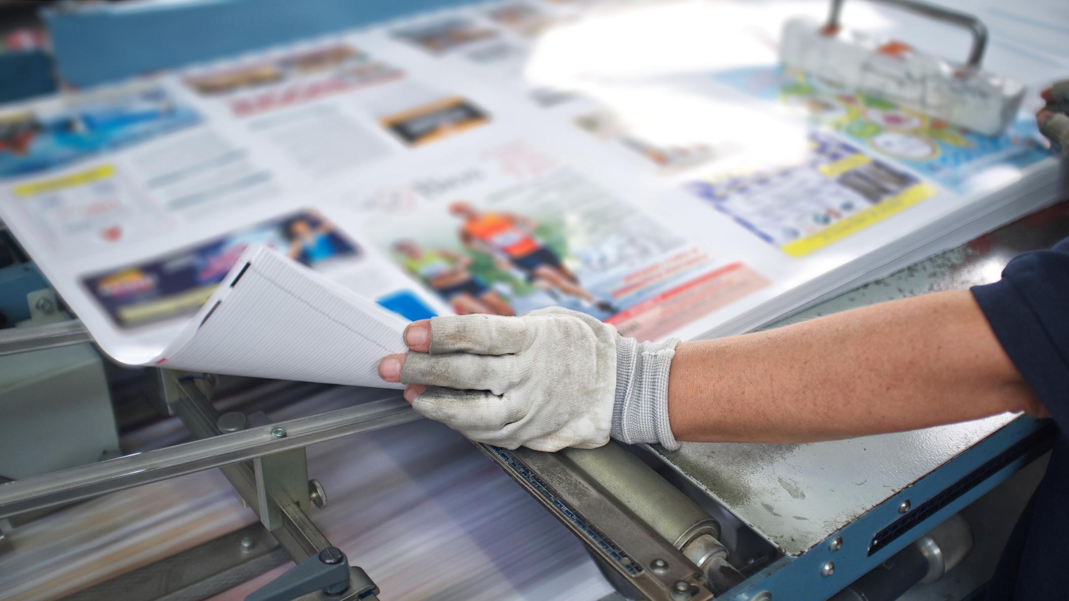Printer looking at a magazine layout