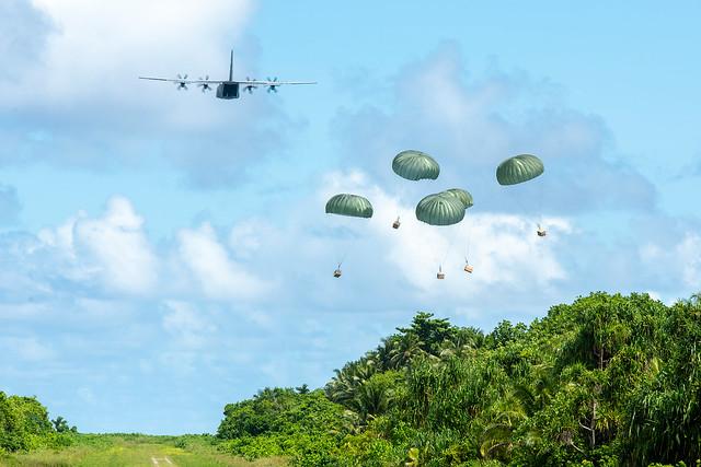 A U.S. Air Force C-130J Super Hercules delivers five humanitarian aid bundles as part of OCD 2019