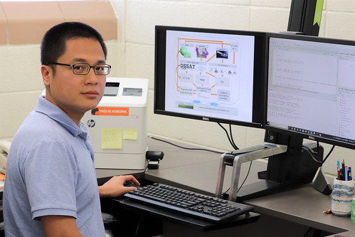 Di Tian sits at a computer.