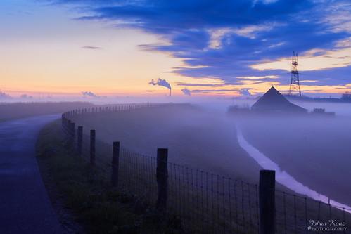 bluehour polder purmer waterland netherlands landscape sunset blue sky dike farmhouse nikon d7500 water powerplant chimney fluegas watervapour road rural