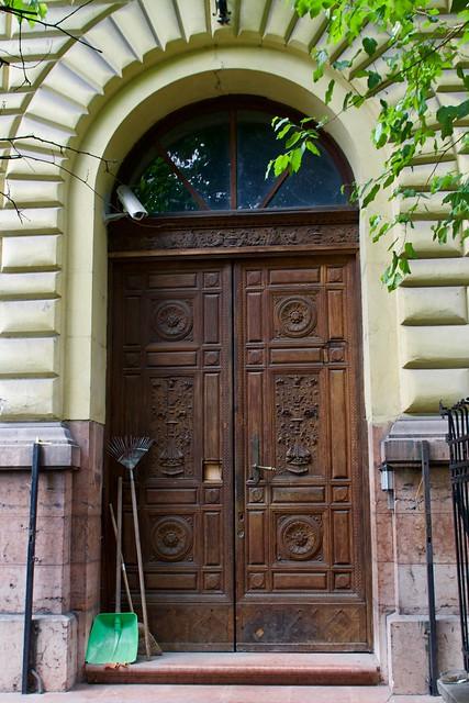 Carved Door with Garden Tools