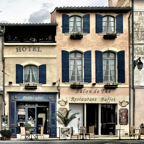 Cute hotel next to a restaurant. From How to Save Money and Time: Expert Shares Top Travel Planning Tips