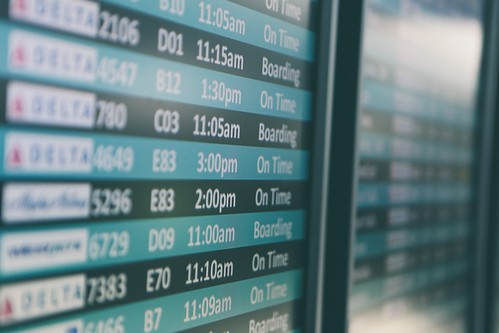 Flight board at the airport. From How to Save Money and Time: Expert Shares Top Travel Planning Tips