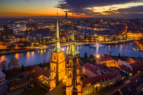 aerial autumn church clouds evening illumination light outdoor river sky sunset water wrocław lowersilesianvoivodeship poland color image no people photography architecture famous place night building exterior illuminated travel destinations cityscape dusk city outdoors sunrise beautiful drone birds eye view fire