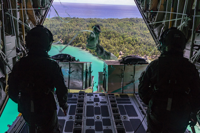 Royal New Zealand Air Forceloadmasters cut free supplies above a Micronesian island