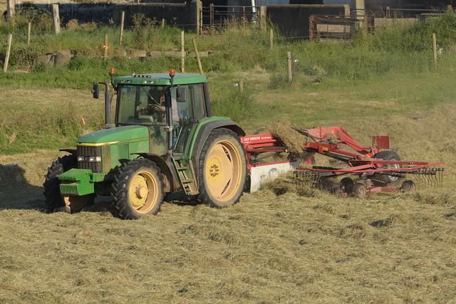 John Deere 6610 Tractor with a Lely Hibiscus 745 CD Vario Rake