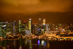 Singapore Cityscape at night...Long exposure shot of Singapore city from top of Marina Sands Bay...