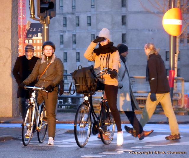 Sun sets on Copenhagen winter girls on bikes