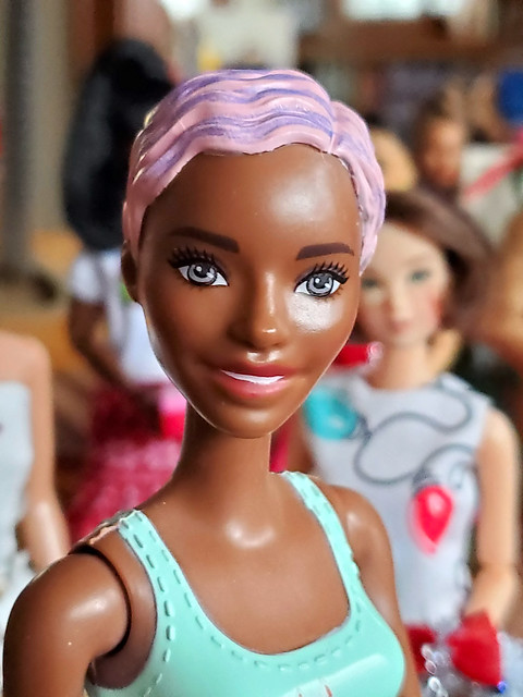 Something about the sculpted pixie and their whole look, reminds me of vintage dolls and mannequins from back in the day.  I love the whole color change makeup and hair thing!  So nice to have an inexpensive doll to enjoy this much.  ;>)