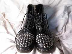 Well worn, studded boots