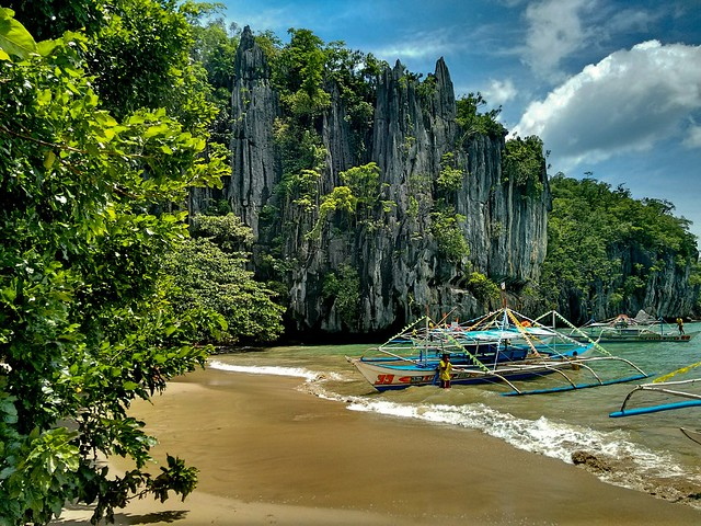 A rock formation in the beachfront of a tropical sea. Palawan Island, Philippines.