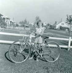 Girl Poses with Bicycle, 1958