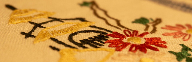 HMM: Handmade embroidery in a corner of a napkin, detail