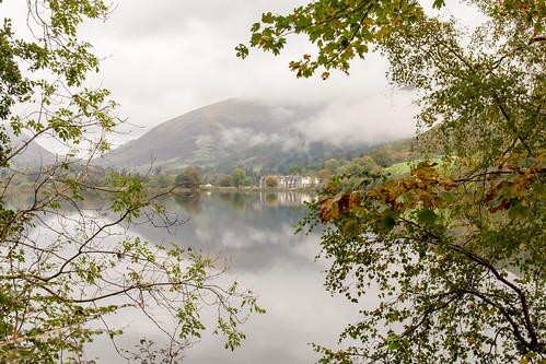 grasmere lake water reflection lakedistrict nationalpark landscape mountain tree woodland building cumbria england english cloud mist