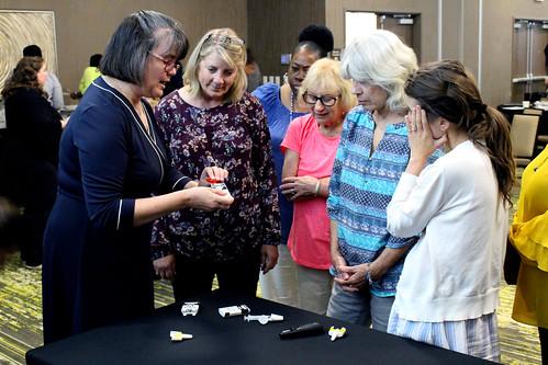 Karen Marlowe explains naloxone to a group of women