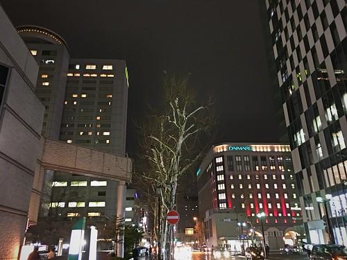 17december2019 edited hokkaido japan sapporo downtown night rain lights traffic buildings