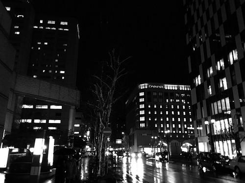 17december2019 edited hokkaido japan grayscale sapporo downtown night rain lights traffic buildings