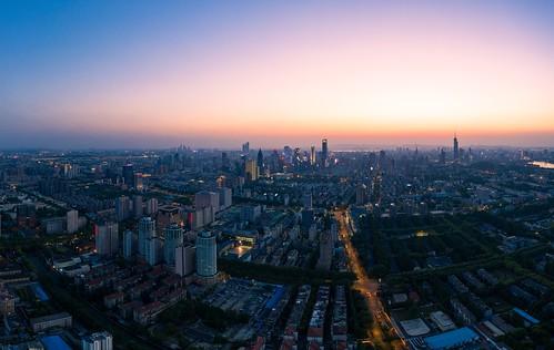 nanjing jiangsu peoplesrepublicofchina urban downtown aerial sky skyline skyscraper landscape landmark dusk sunset twilight horizon city cityscape