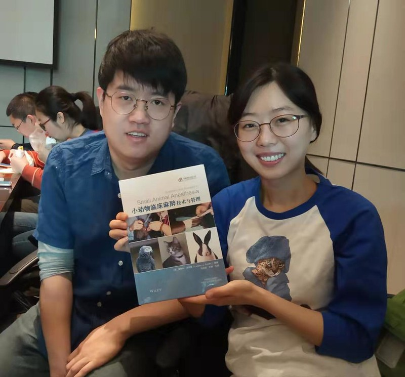 Max, vice-president of the Chinese Veterinary Anaesthesia Association with the latest edition of Small Animal Anaesthesia in Chinese