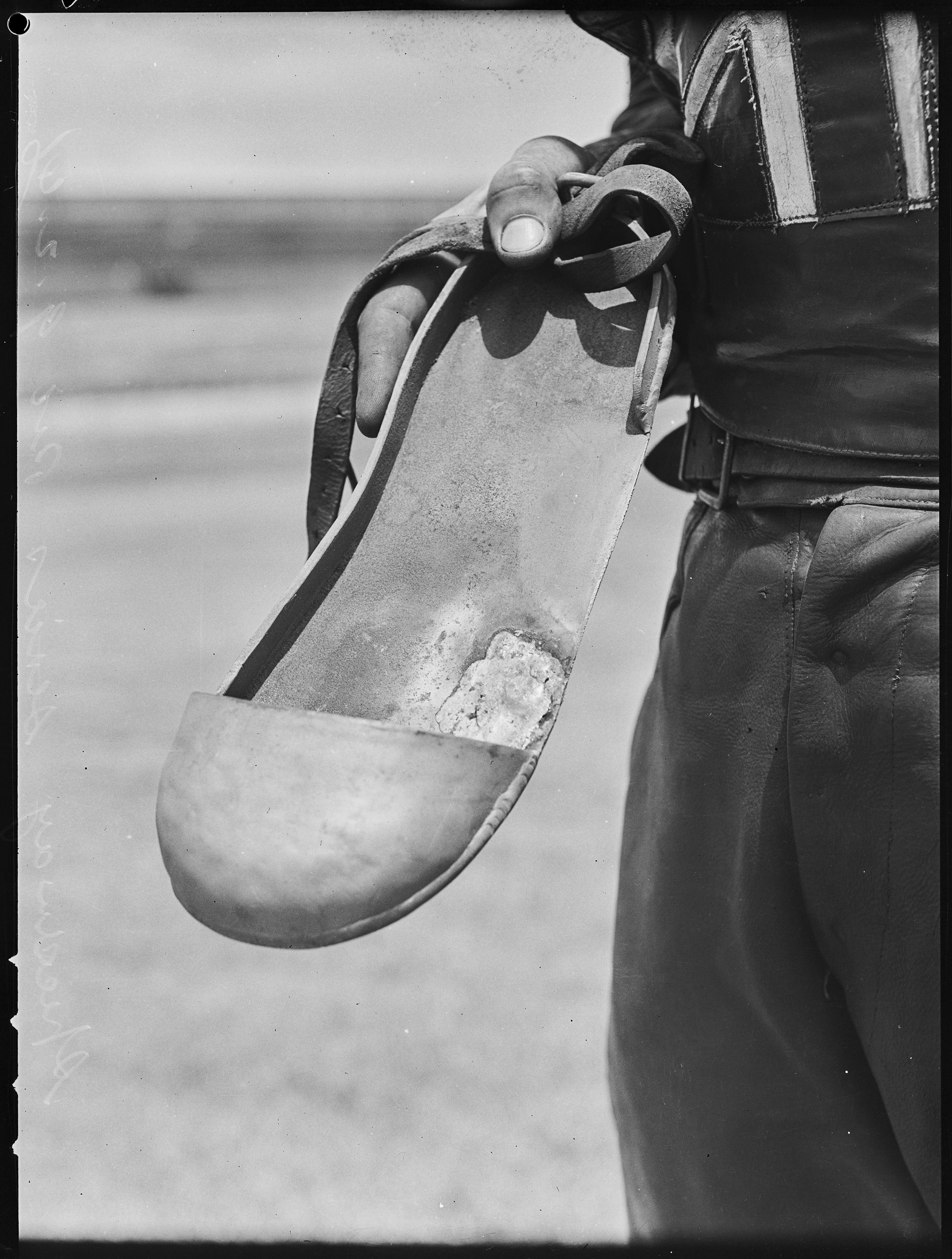 Metal shoe cover worn by speedway cyclist, 9 February 1946, photo by Ray Olson