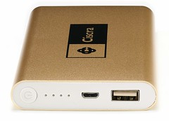Metal gold coloured power bank, switch and connector end.