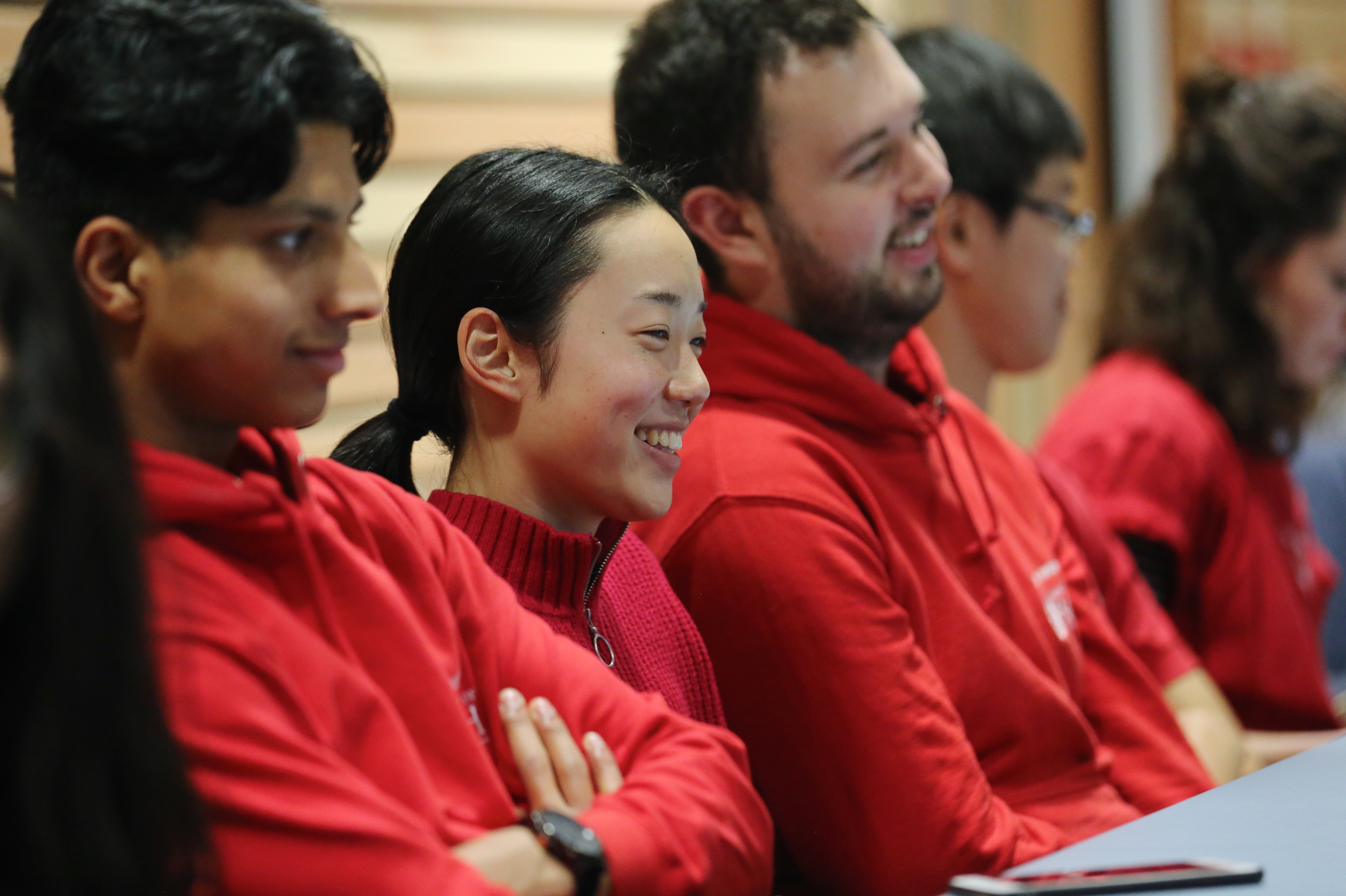 Undergraduates in red hoodies sat down watching the awards