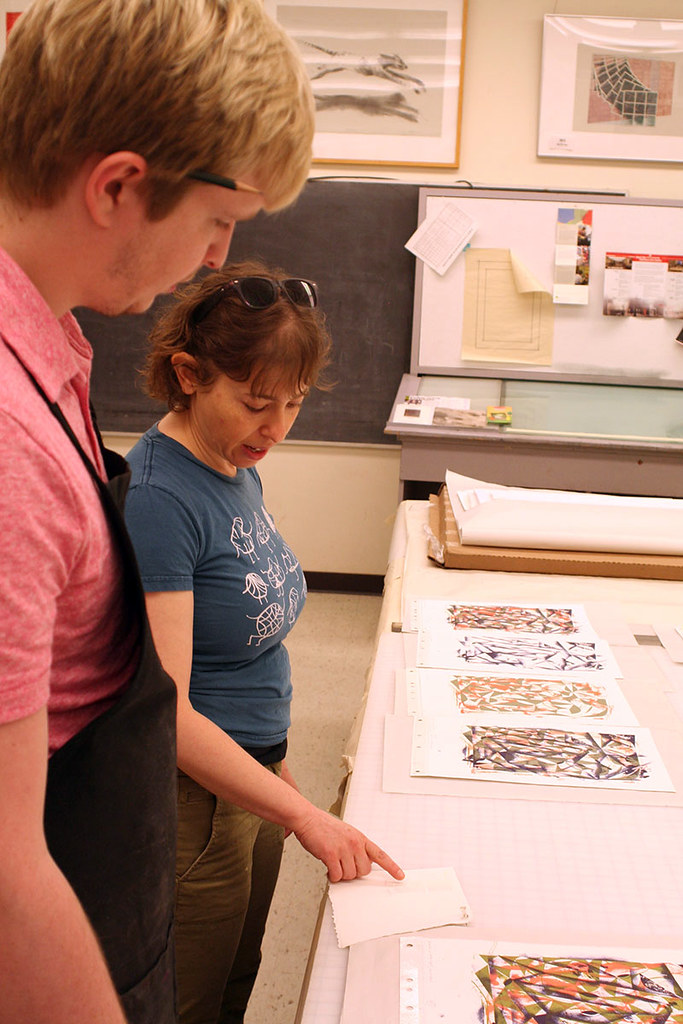 printer and artist reviewing proofs