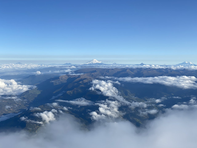 Cotopaxi from the Summit of the Active and Mighty Stratovolcano 'Tungurahua' ('Throat of Fire' volcano) at 5,023 meters (16,479 feet) above sea level, Baños, the Central Highlands, Ecuador.