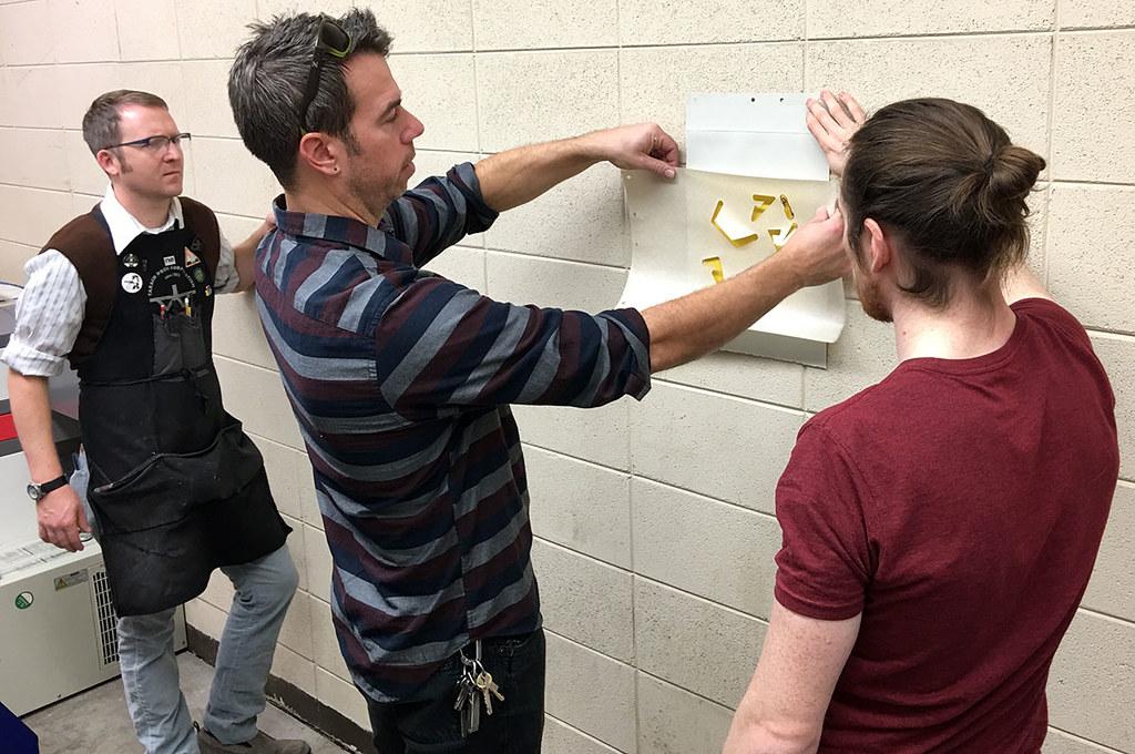 reviewing laser cut samples