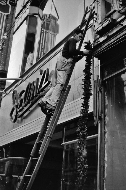 Deck the Halls: Hanging Christmas decorations in Providence, Rhode Island, December 1940.