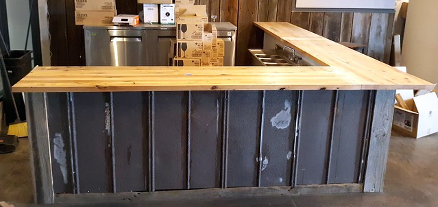 Reclaimed white oak Bar Tops, Thin Man Brewery. Reclaimed tin roof from a barn we deconstructed.