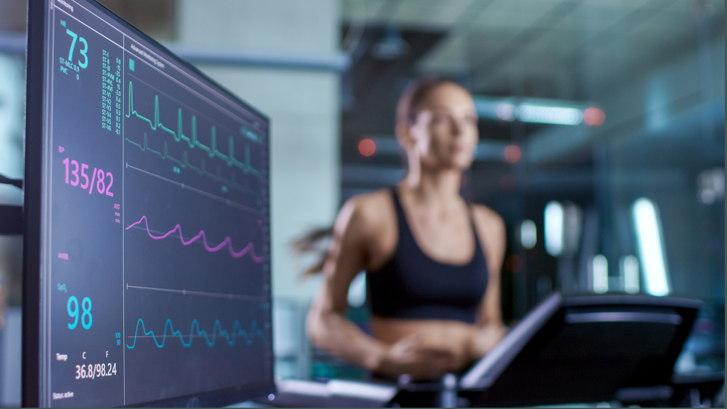 Computer screen with data and woman on treadmill