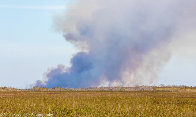 I'm guessing this is a sugar cane field burning - this was a fairly common sight