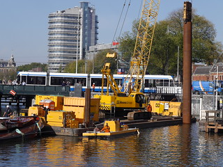 Free photo Amsterdam: picture of construction works in the canal-water, in front of Central Station Amsterdam - free pics