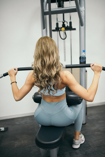 Strong attractive and healthy blonde girl working out in gym | by shixart1985