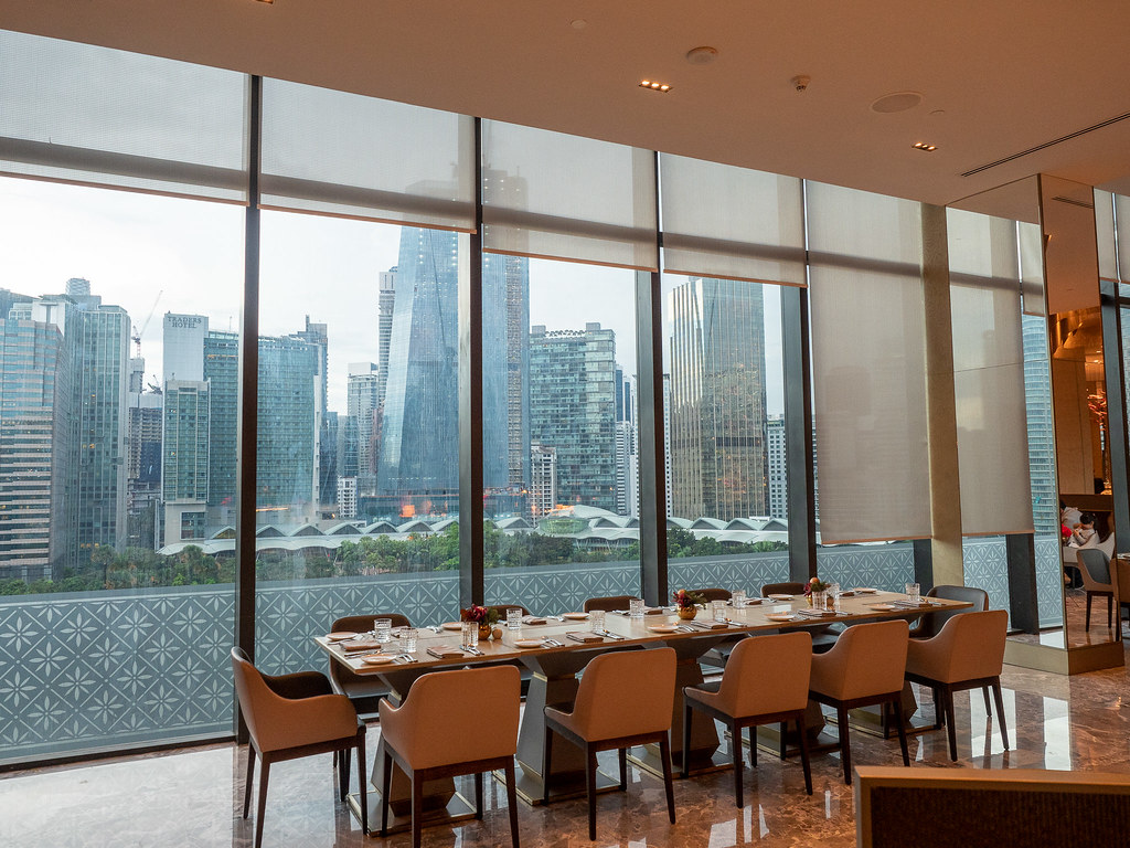 A long table with Kuala Lumpur view in the buffet restaurant.
