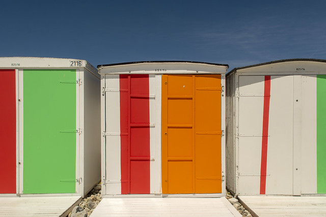 Beach huts with orange, green and red
