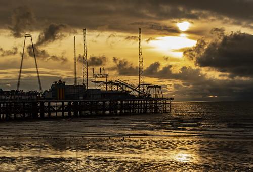 blackpool pier shore sea sunset england beach clouds