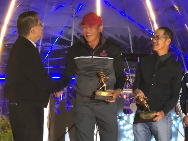ECY receives golf trophy
