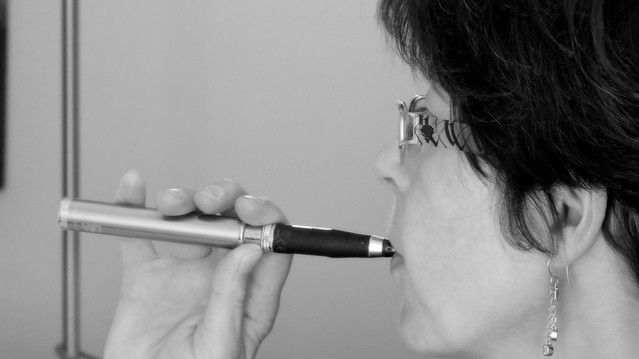 Woman and electronic cigarette