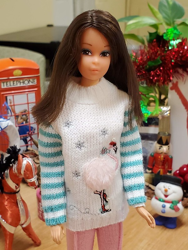 I love this Christopher Banks sweater ornament from this year on her.  The pants are from some vintage outfit, but I have no idea which one, and who it was for!