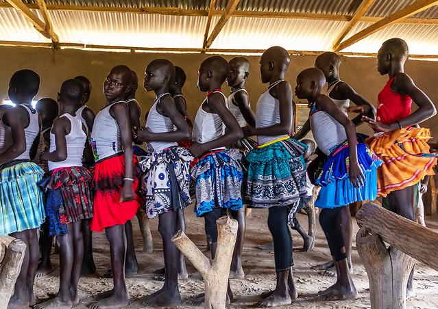 Mundari tribe girls dancing and singing during a sunday mass in a church, Central Equatoria, Terekeka, South Sudan