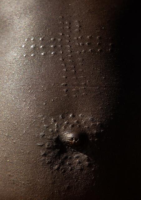 Mundari tribe woman scarifications on the belly in a cross shape, Central Equatoria, Terekeka, South Sudan